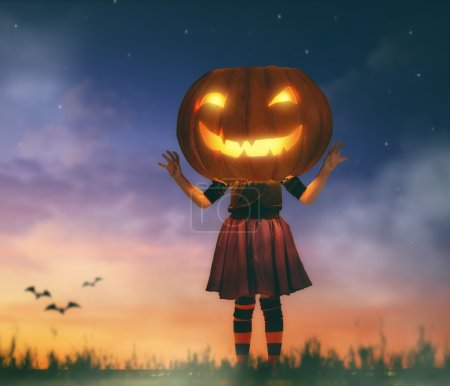 Kid with a big pumpkin head