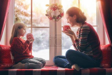 mother and her daughter enjoying hot tea
