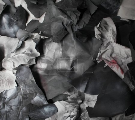 monochrome background of torn pieces of black and white paper