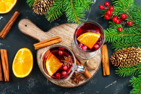 christmas drink with fruits and aroma spices