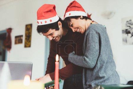 couple wrapping christmas present
