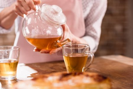 woman pouring hot tea