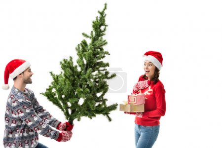 man showing christmas tree to girlfriend