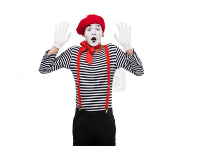 shocked mime standing with hands up isolated on white