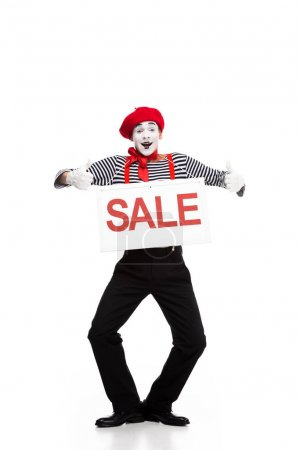 happy mime holding sale signboard and showing thumbs up isolated on white