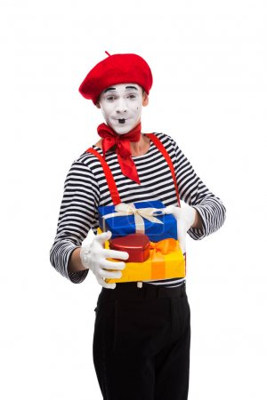 happy mime holding gift boxes isolated on white