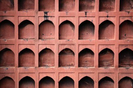 Wall in Indian style have a dented burned  from candle.