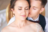Groom and bride together. Wedding couple. Close up portrait of beautiful wedding couple indoors