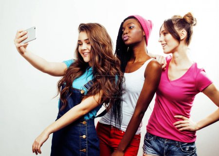 Multi nation girls group taking selfie