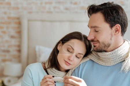 Positive couple sitting at home
