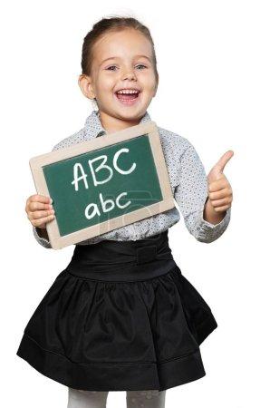 Cute little schoolgirl with  blackboard