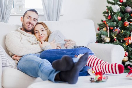 Young couple in love on Christmas night