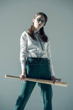 hipster woman holding baseball bat