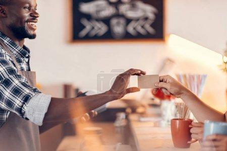 barista taking credit card