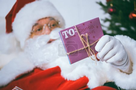 santa claus with letter in hand